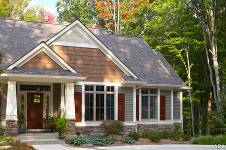 The latest color trend for home exteriors includes darker shades of