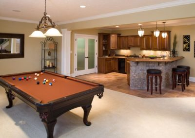 Lower level game room and bar in residential home.