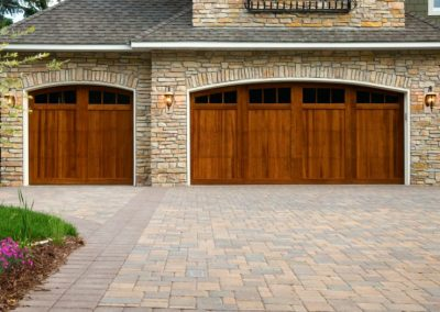 Pavers, custom doors, and stone on custom home.